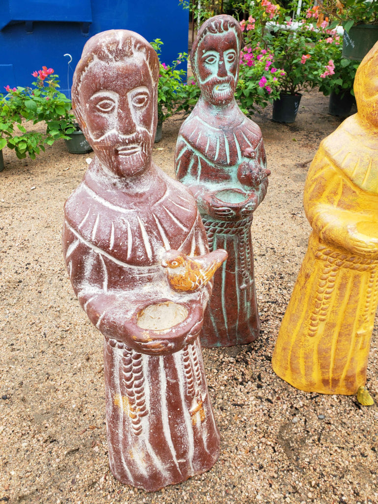 St. Francis Assisi with bird, clay statue.