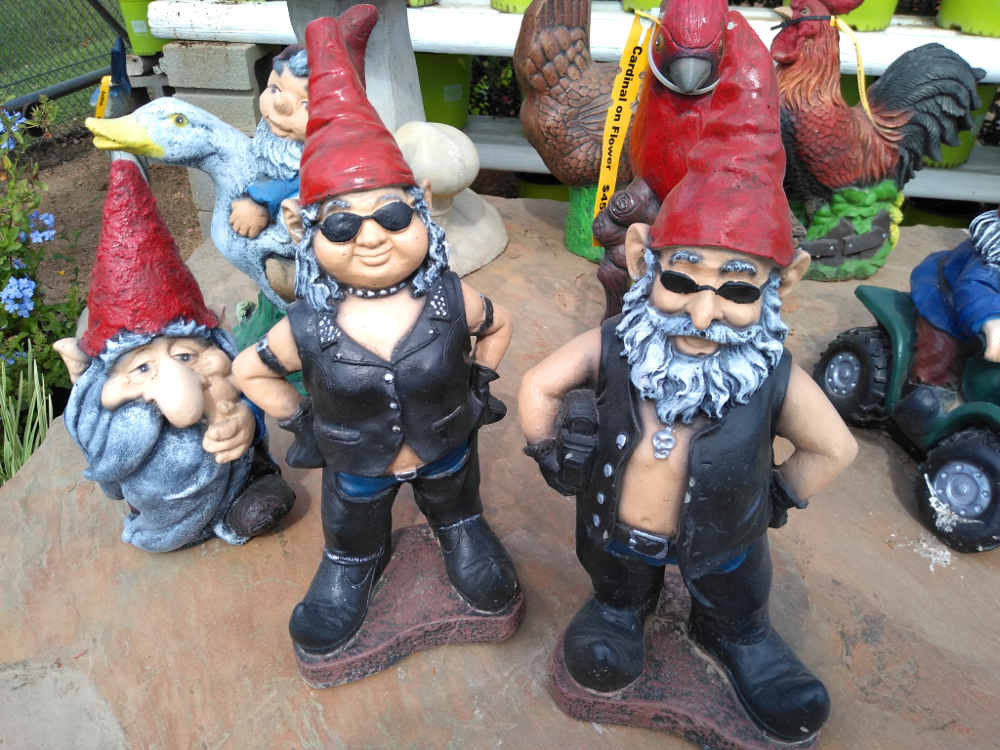 Cement biker gnomes yard decorations.