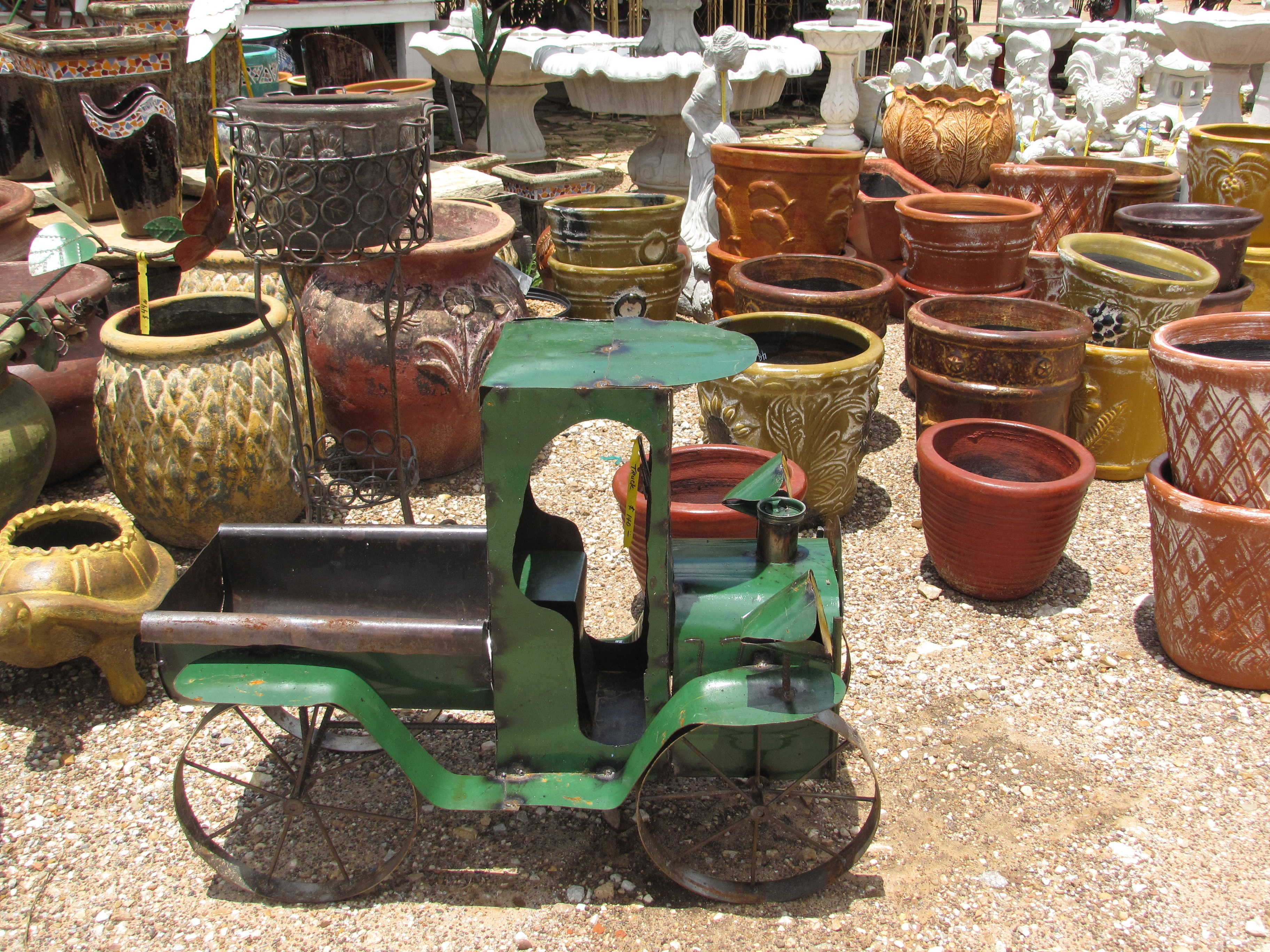Many kinds of yard decor such as iron, cement and pottery at J&J Nursery, Spring, TX.